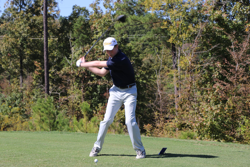 2019 boys golf action shot
